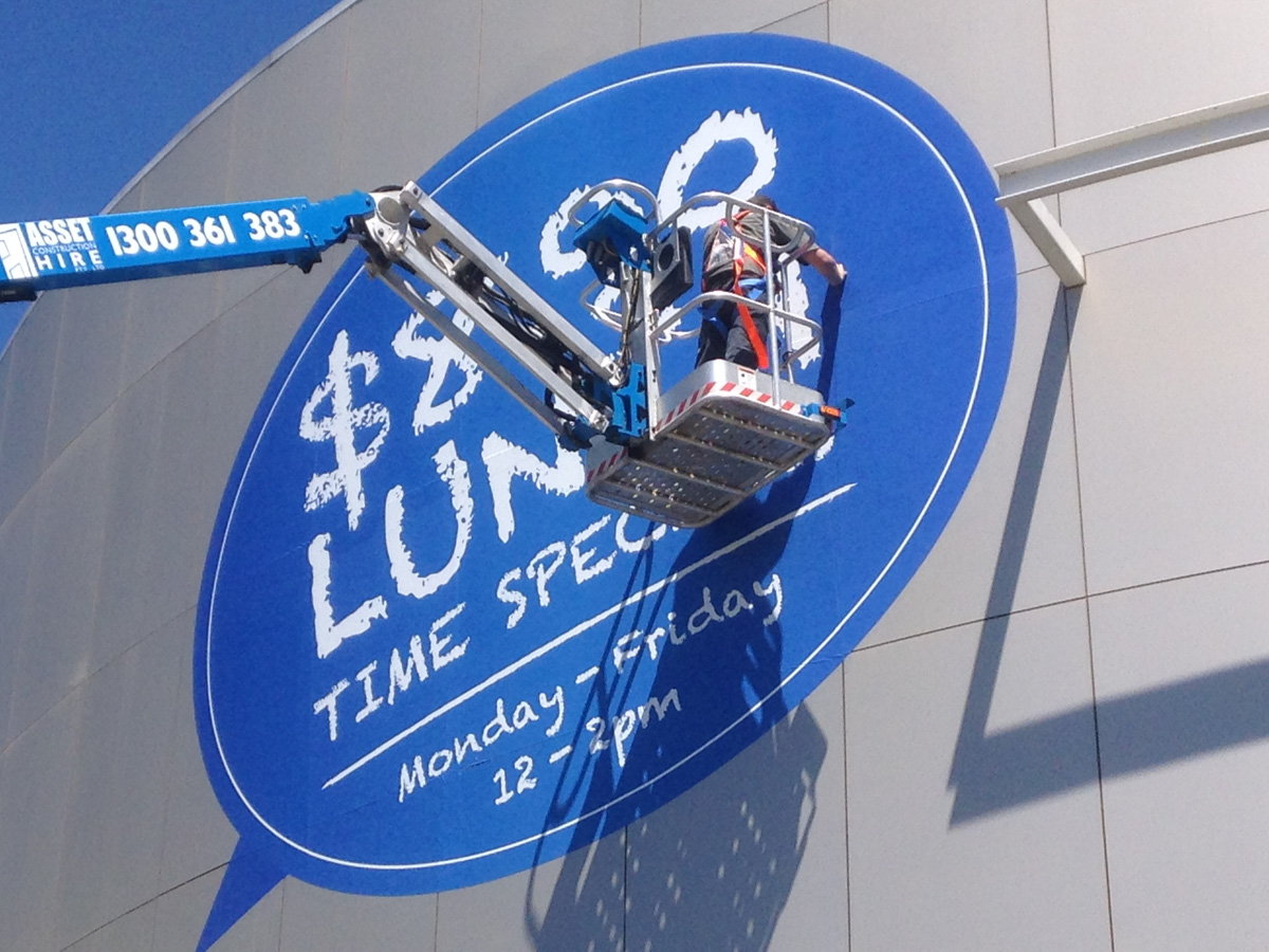 Signage installation of large format print by Fresh Creative