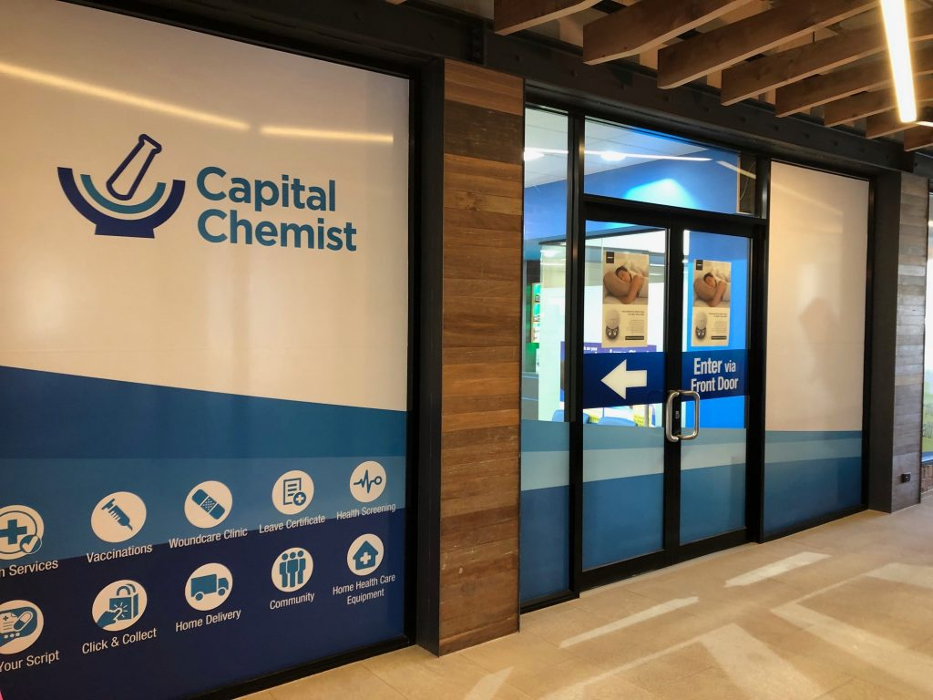 Capital Chemist shop signage at the back